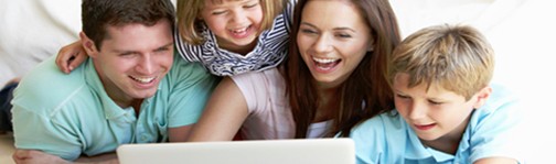 computer with kids and parents